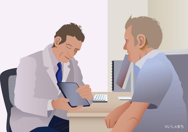 診療中の医者と患者