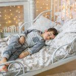 Cute Little boy sleeps in a room