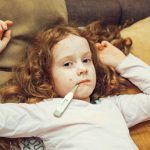 Child measuring temperature. Varicella zoster virus or Chickenpo