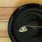Mackerel fishbone on the black dish